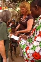 Nurse Cindy examining the orphaned kids