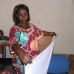 Annie making school uniforms