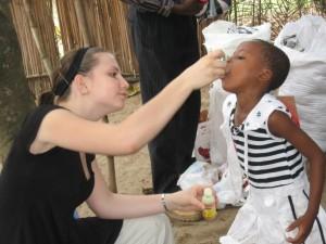 F37_Natalie distributing vitamins
