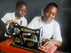 Amissi teaching Benedicte tailoring