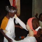 Natalie helping orphaned kids dress up for Christmas skit back in 2009