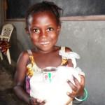 Orphaned girl receiving food package