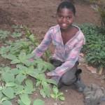 Orphaned girl tending to her garden