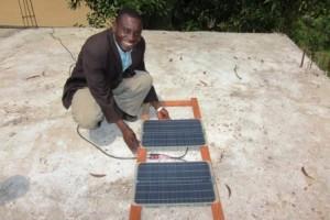 15_Installing solar panels on the roof for maternity kit