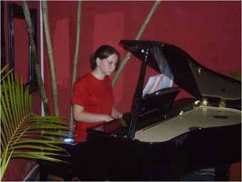 Playing piano at the Sai Sai Club