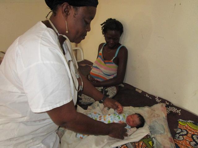 Florence giving newborn baby medical checkup,