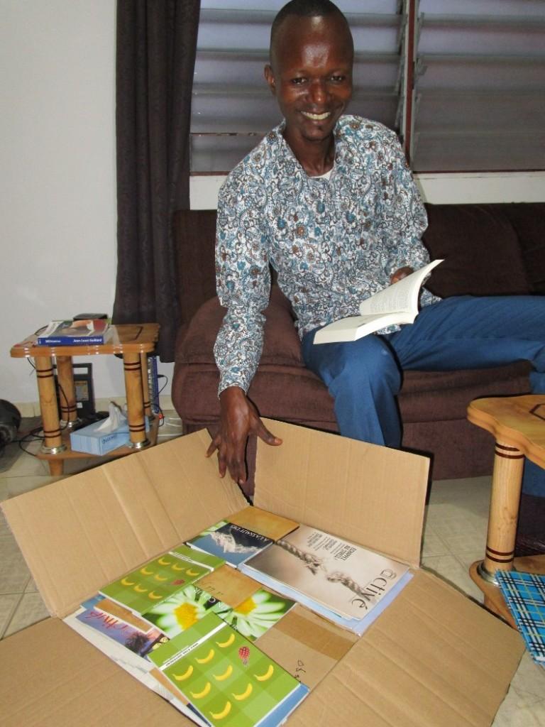 Patrick preparing to take booklets to Bas Congo