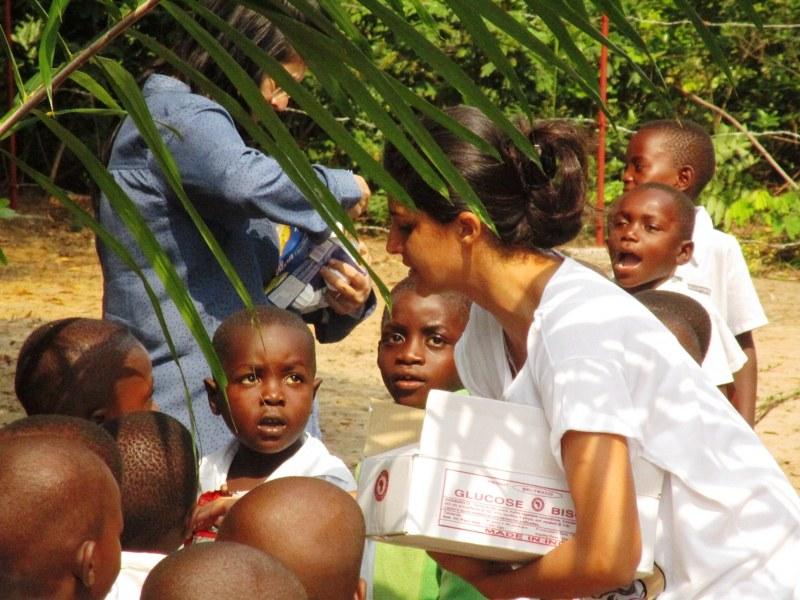Sameera distributing cookies and yoghurts to the kids