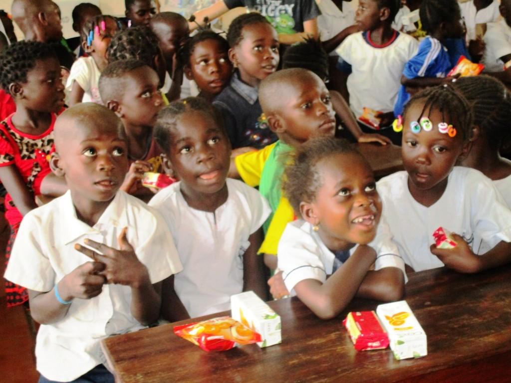 Kids enjoying snack while watching a video