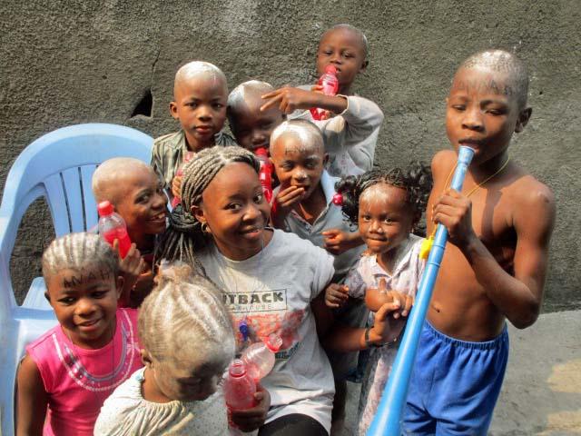 Neighborhood children congratulating Ana for her success.