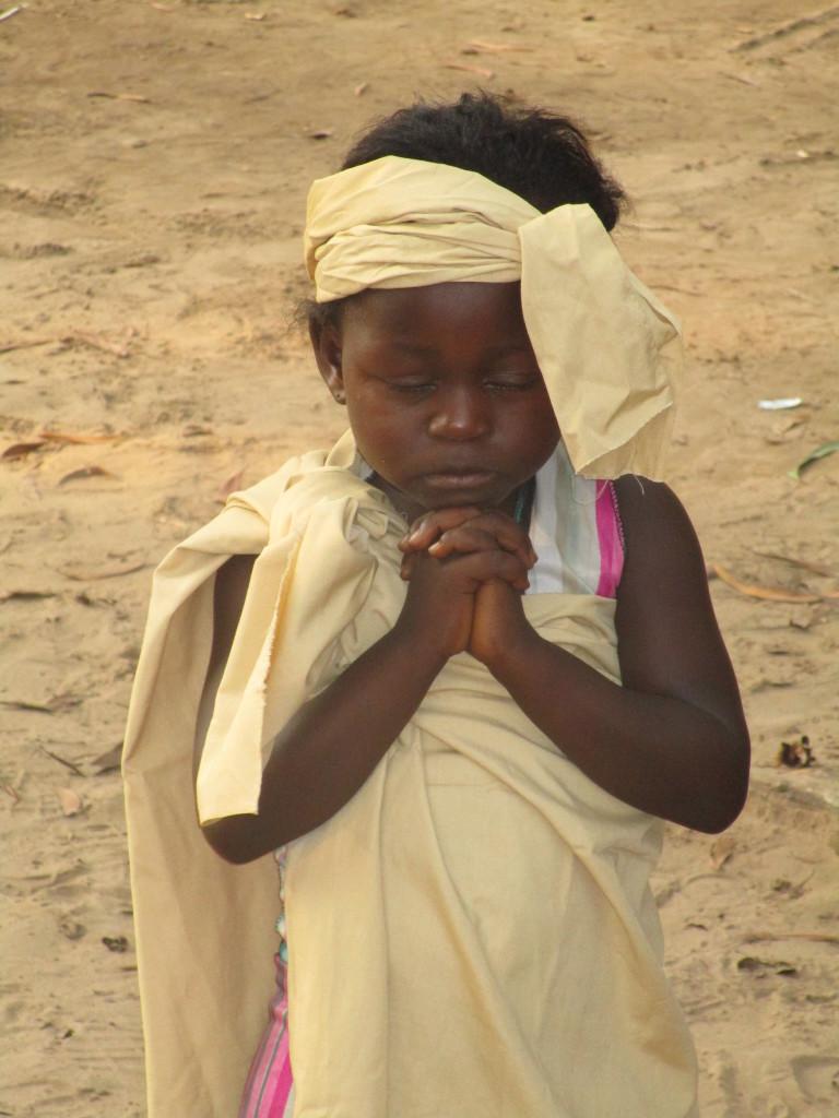Kikimi child dressed up as a shepherd boy